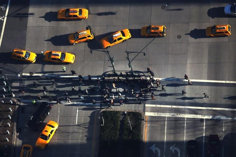 Pedestrians cross the street below One World Trade Center at the Ground Zero site. (Spencer Platt/Getty Images)