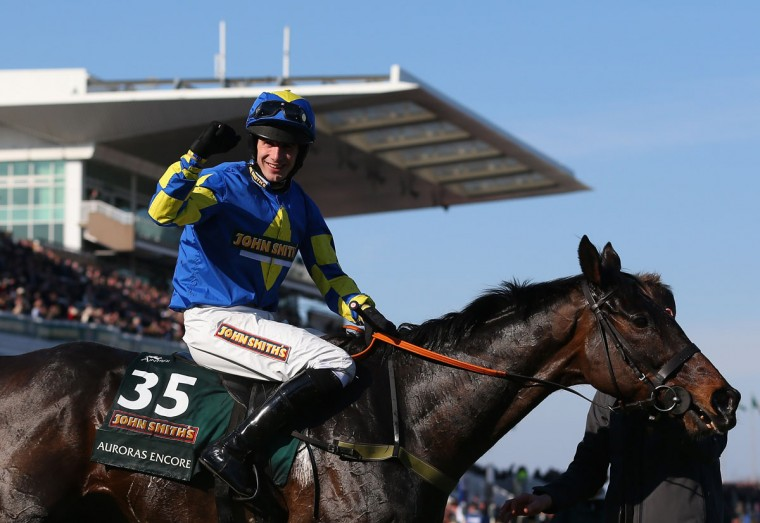 Auroras Encore ridden by Ryan Mania celebrates winning the Grand National Steeplechase at Aintree Racecourse on April 6, 2013 in Liverpool, England. (Julian Finney/Getty Images)