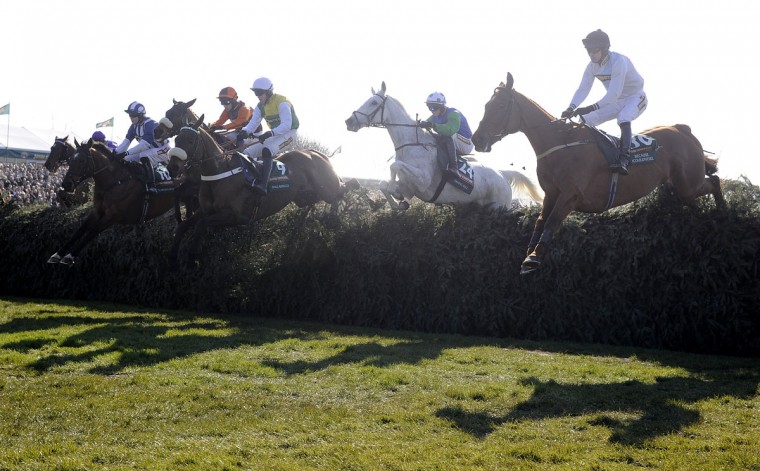 All the runners clear the first fence in the Grand National Steeplechase at Aintree racecourse on April 06, 2013 in Liverpool, England. (Alan Crowhurst/Getty Images)