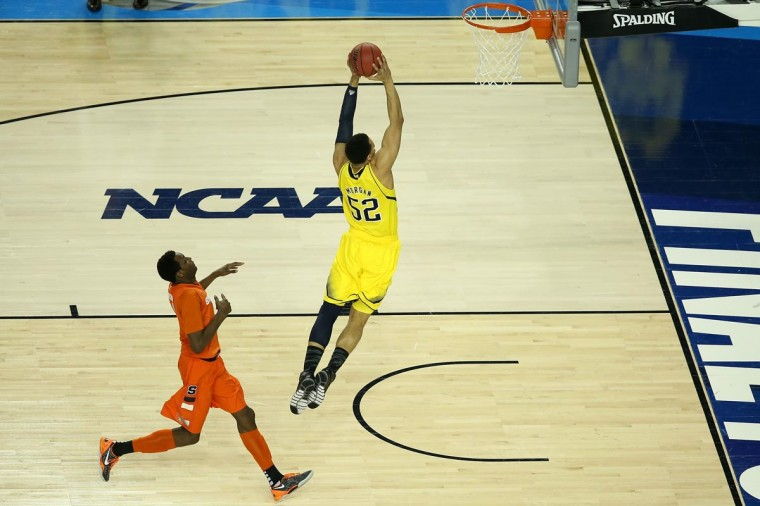 Jordan Morgan #52 of the Michigan Wolverines dunks the ball in the final seconds before the Wolverines defeat the Syracuse Orange 61-56 during the 2013 NCAA Men's Final Four Semifinal at the Georgia Dome on April 6, 2013 in Atlanta, Georgia. (Photo by Andy Lyons/Getty Images)