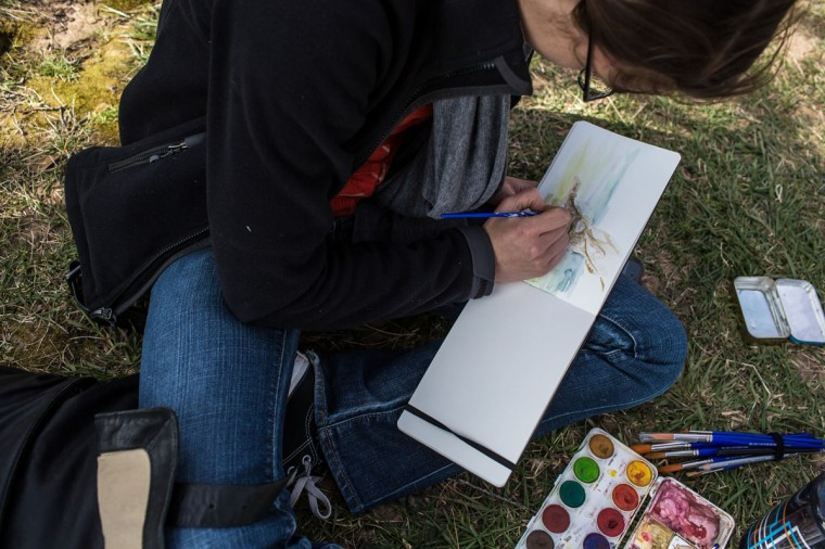 April 7, 2013: Cleo van der Veen paints a watercolor picture of blossoming cherry trees in Washington, DC. (Brendan Hoffman/Getty Images)