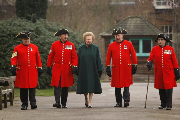 Lady Margaret Thatcher walks with Chelsea pensioners (L-R) John Walker, Charles McLaughlin, David Pultney and John Ley during a photocall for the announcement of the naming of the new firmary at the Royal Chelsea Hospital on February 14, 2008 in London, England. (Daniel Berehulak/Getty Images)