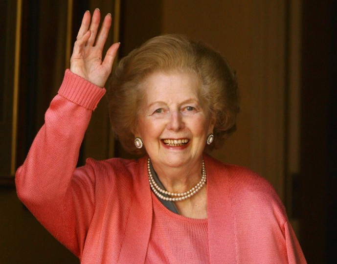 Baroness Thatcher waves from the front door of her home after returning from the Chelsea and Westminster Hospital following an operation on her broken arm on June 29, 2009 in London, England. (Oli Scarff/Getty Images)