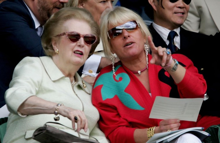 Baroness Margaret Thatcher (L) and daughter Carol Thatcher watch the match between Justine Henin-Hardenne of Belgium and Amelie Mauresmo of France during the women's final match on day twelve of the Wimbledon Lawn Tennis Championships at the All England Lawn Tennis and Croquet Club on July 8, 2006 in London, England. (Phil Cole/Getty Images)