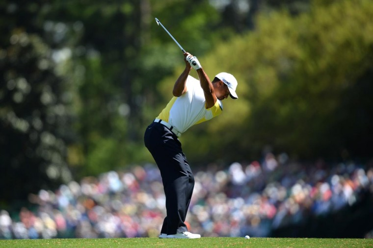 Tiger Woods of the United States hits a shot on the fifth hole during the second round of the 2013 Masters Tournament at Augusta National Golf Club on April 12, 2013 in Augusta, Georgia. (Harry How/Getty Images)