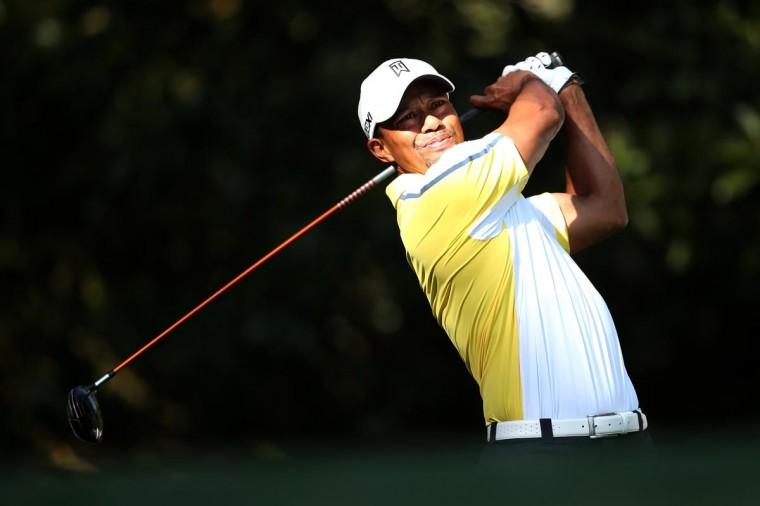 Tiger Woods of the United States hits a a tee shot on the 11th hole during the second round of the 2013 Masters Tournament at Augusta National Golf Club on April 12, 2013 in Augusta, Georgia. (Andrew Redington/Getty Images)