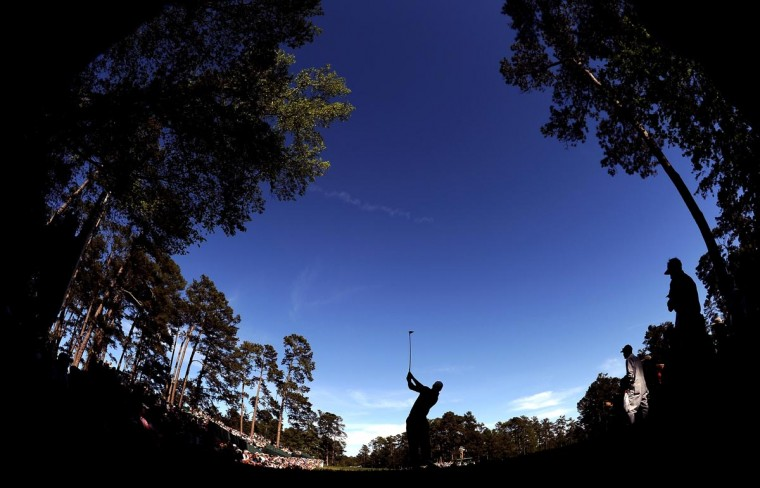 Tiger Woods of the United States hits his tee shot on the 14th hole during the third round of the 2013 Masters Tournament at Augusta National Golf Club on April 13, 2013 in Augusta, Georgia. (Harry How/Getty Images)