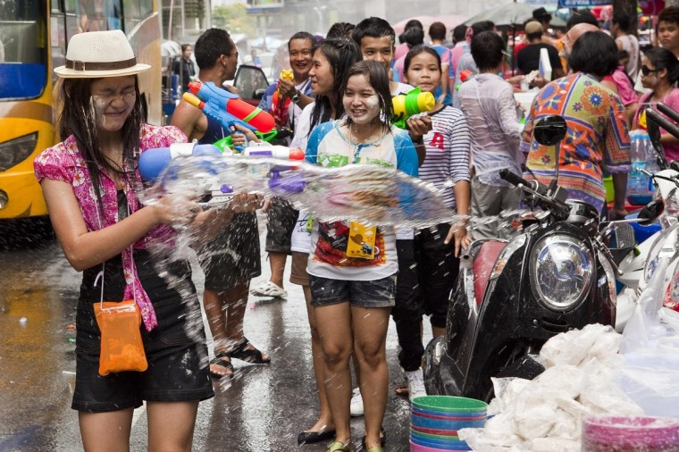 A woman reacts to being soaked by water during a community water fight as part of the Songkran water festival on April 14, 2013 in Bangkok, Thailand. The Songkran festival marks the traditional Thai New Year and is celebrated each year from April 13 to 15. The throwing of water originated as a way to pay respect to people and is meant as a symbol of cleansing and purification.(Jack Kurtz/Getty Images)