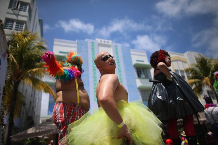 People participate in the Fifth annual Miami Beach Gay Pride Parade along Ocean Drive on April 14, 2013 in Miami Beach, Florida. The event which drew tens of thousands to watch featured a record number of participants according to the event organizers, with 73 float entries and 1,500 people walking with their organizations. (Joe Raedle/Getty Images)