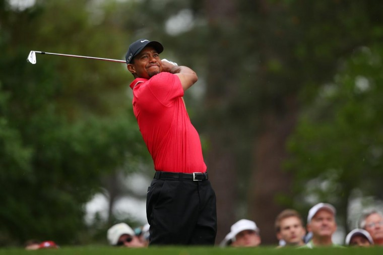 Tiger Woods of the United States hits a shot on the fourth hole during the final round of the 2013 Masters Tournament at Augusta National Golf Club on April 14, 2013 in Augusta, Georgia. (Mike Ehrmann/Getty Images)