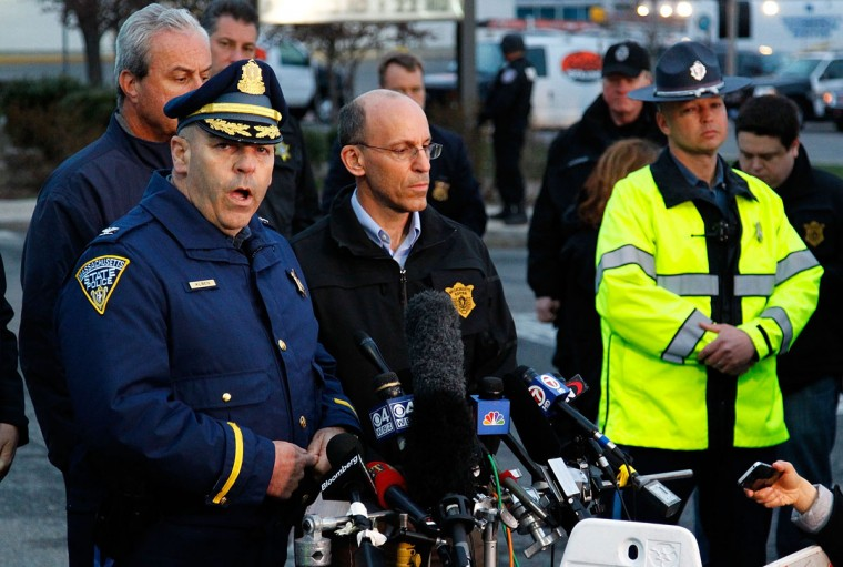 Boston Police Commissioner Edward Davis speaks during a media briefing in the parking lot of the Watertown Mall on April 19, 2013 in Watertown, Massachusetts. Earlier, a Massachusetts Institute of Technology campus police officer was shot and killed late Thursday night at the school's campus in Cambridge. A short time later, police reported exchanging gunfire with alleged carjackers in Watertown, a city near Cambridge. According to reports, one suspect has been killed during a car chase and the police are seeking another - believed to be the same person (known as Suspect Two) wanted in connection with the deadly bombing at the Boston Marathon earlier this week. Police have confirmed that the dead assailant is Suspect One from the recently released marathon bombing photographs. (Jared Wickerham/Getty Images)
