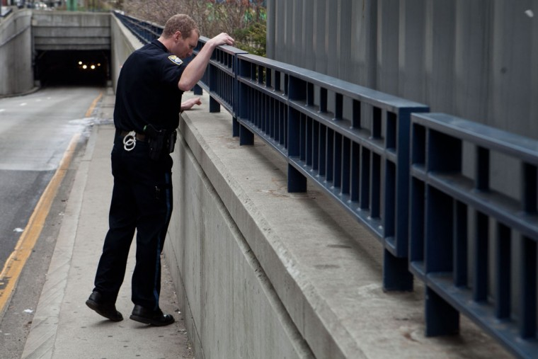 A Boston Police officer searches around the perimeter of South Station for suspicious material after two bullets were found outside of the T stop on April 19, 2013 in Boston, Massachusetts. South Station was shut down and heavily guarded with police in response to the early morning shootings in Cambridge and Watertown, Massachusetts. After a car chase and shoot out with police, one suspect in the Boston Marathon bombing, Tamerlan Tsarnaev, 26, was shot and killed by police early morning April 19, and a manhunt is underway for his brother and second suspect, 19-year-old suspect Dzhokhar A. Tsarnaev. The two men, reportedly Chechen origin, are suspects in the bombings at the Boston Marathon on April 15, that killed three people and wounded at least 170. (Kayana Szymczak/Getty Images)