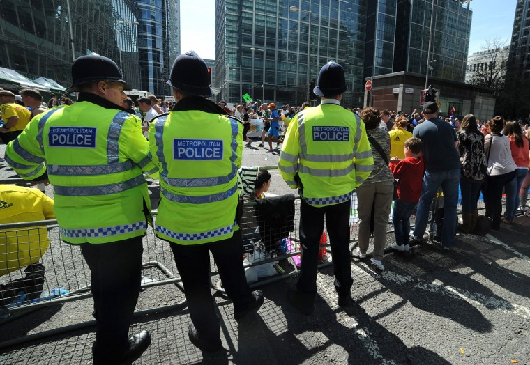 The police keep tabs on the race. (Charlie Crowhurst/Getty Images)