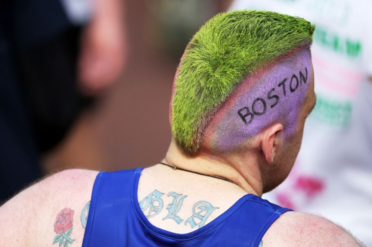 A competitor shows his sympathy towards the victims of the Boston Marathon bombing during the Virgin London Marathon. (Chris Jackson/Getty Images)