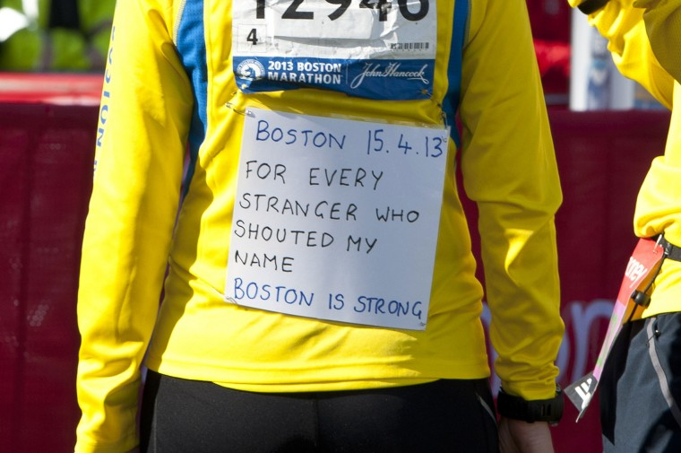 Boston Marathon participant Tricia Bun poses for photographs ahead of the Virgin London Marathon. (Ben A. Pruchnie/Getty Images)