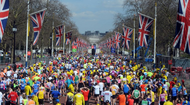 Competitors stream past the finish line during the Virgin London Marathon. (Chris Jackson/Getty Images)