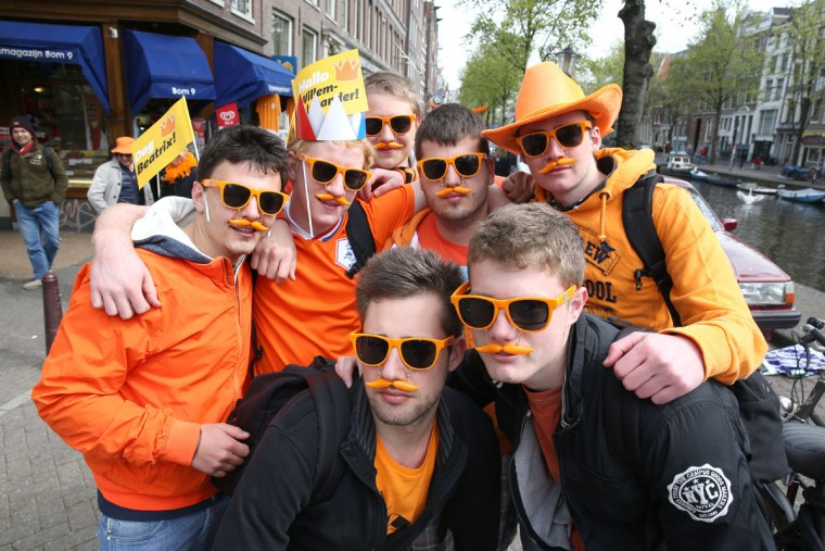 Spectators celebrate the inauguration of King Willem-Alexander of the Netherlands as Queen Beatrix of the Netherlands abdicates on April 30, 2013 in Amsterdam, Netherlands. (Chris Jackson/Getty Images)