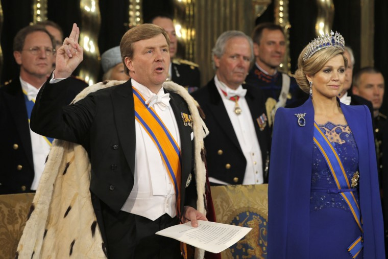 HM King Willem-Alexander of the Netherlands takes the oath as his wife HRH Queen Maxima of the Netherlands looks on during their inauguration ceremony at New Church on April 30, 2013 in Amsterdam, Netherlands. (Peter Dejong-Pool/Getty Images)