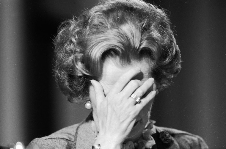 British prime minister Margaret Thatcher covering her face with her hand at the 1985 Conservative Party Conference. (Keystone/Getty Images)