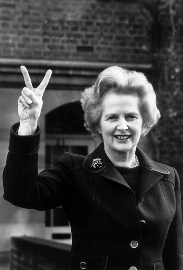 Conservative party leader Margaret Thatcher makes a 'victory' sign outside her home in Chelsea, London on November 1976. (John Minihan/Evening Standard/Getty Images)
