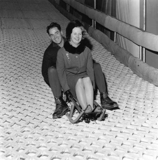 Conservative MP Margaret Thatcher has fun on a ski run in Battersea Park with instructor Joe Hoki on December 7, 1962. (Reg Lancaster/Express/Getty Images)