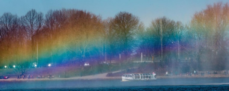 A rainbow is reflected in a fountain on the river Alster, on April 1, 2013 in Hamburg, northern Germany. After cold weather in the last weeks, temperatures raised to 5 degrees in northern Germany. (Markus Scholz/AFP/Getty Images)