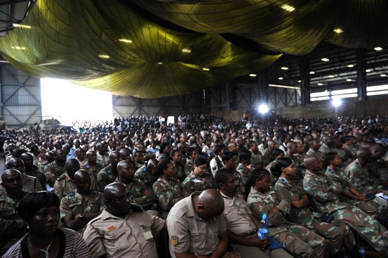 "Soldiers attend a memorial service for the South African soldiers who died during a battle with rebels in the Central African Republic at Swartzkop Air Force Base in Pretoria on April 2, 2013. Thirteen soldiers were killed on March 23, 2013 on the outskirts of Bangui, 27 others were wounded. South African President Jacob Zuma who is facing anger at home dismissed claims that South African troops deployed in restive Central Africa were protecting private business interests as ""conspiracy theories."" (Stephane De Sakutin/AFP/Getty Images)"