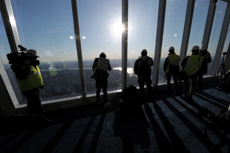 People look at the view as officials from The Durst Organization, Legends Hospitality LLC and The Port Authority of New York & New Jersey give a preview to the news media. (Stan Hondastan/Getty Images)