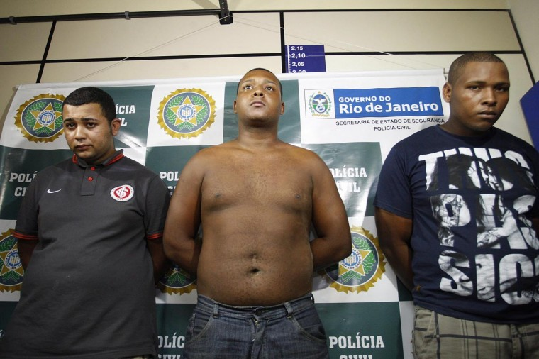 Jonathan Froudakis de Souza, Carlos Armando Costa dos Santos and Wallace Aparecido Silva (L-R) who allegedly raped a foreign tourist in a minibus in Rio de Janeiro on March 30, 2013 are presented to the press in Rio on April 2, 2013. The three are accused of the rape of an American student who was assaulted as her French boyfriend was forced to look on during a horrific six-hour abduction aboard a Rio minibus, local media reported. (Márcio Alves/AFP/Getty Images)