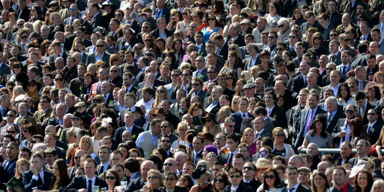 Racegoers follow the first race on the final day of the Grand National horse race at Aintree Racecourse in Liverpool, north-west England, on April 6, 2013. (Andrew Yates/AFP/Getty Images)