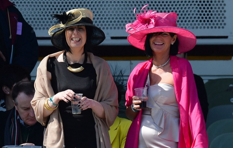 Racegoers follow the first race on the final day of the Grand National meeting horse race at Aintree Racecourse in Liverpool, north-west England, on April 6, 2013. (Andrew Yates/AFP/Getty Images)