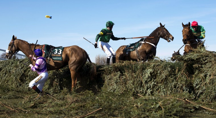 Mumbles Head, ridden by Jamie Moore, (left) refuses the last fence in front of Roberto Goldback (center) ridden by Barry Geraghty, as Quiscover Fontaine (right) ridden by DJ Casey runs into the fence during the Grand National Steeplechase at Aintree Racecourse in Liverpool, north-west England, on April 6, 2013. (Adrian Dennis/AFP/Getty Images)