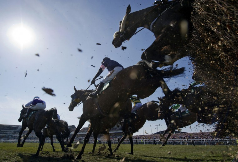 "Horses jump ""The Chair"" during the Grand National horse race at Aintree Racecourse in Liverpool, north-west England, on April 6, 2013. (Adrian Dennis/AFP/Getty Images)"