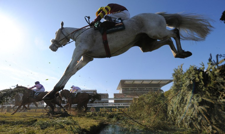 Chicago Grey, ridden by Paul Carberry, jumps the water jump during the Grand National horse race at Aintree Racecourse in Liverpool, north-west England on April 6, 2013. (Andrew Yates/AFP/Getty Images)