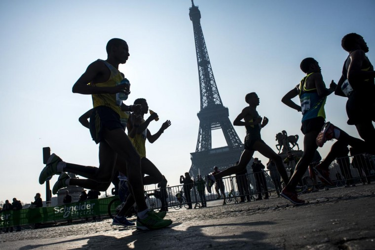 Competitors run past the Eiffel tower during the 37th edition of the Paris Marathon on April 7, 2013 in Paris. (Fred Dufour/AFP/Getty Images)