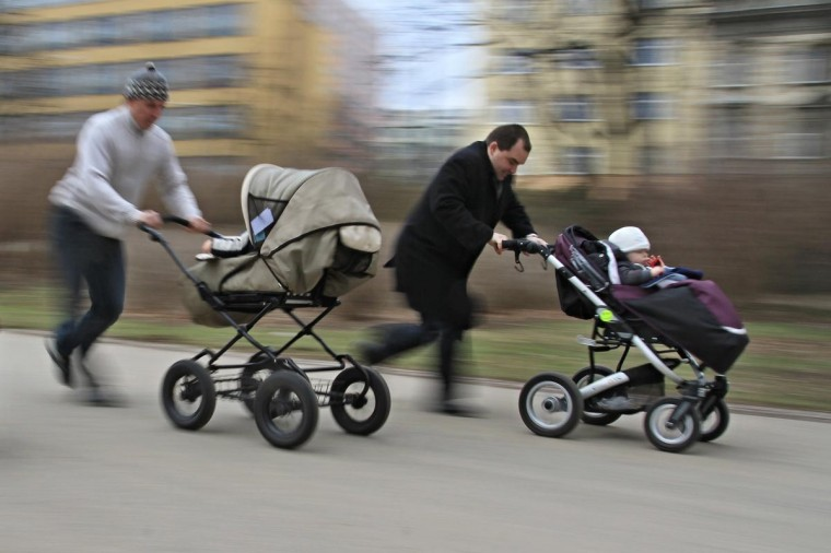Two men push their children in a stroller during the race walking competition in Brno, Czech Republic on April 7, 2013, the World Health Day. The Stroller Racing World Health Day event was celebrated nationwide on 25 different locations in the Czech Republic, with competitions for mothers, fathers and the entire family. (Radek Mic/AFP/Getty Images)