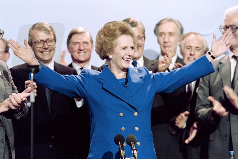 A picture dated Ocotber 13, 1989 shows then British Prime Minister Margaret Thatcher acknowledging applaud on at the end of the Conservative Party conference in Blackpool. (Johnny Eggitt/AFP/Getty Images)