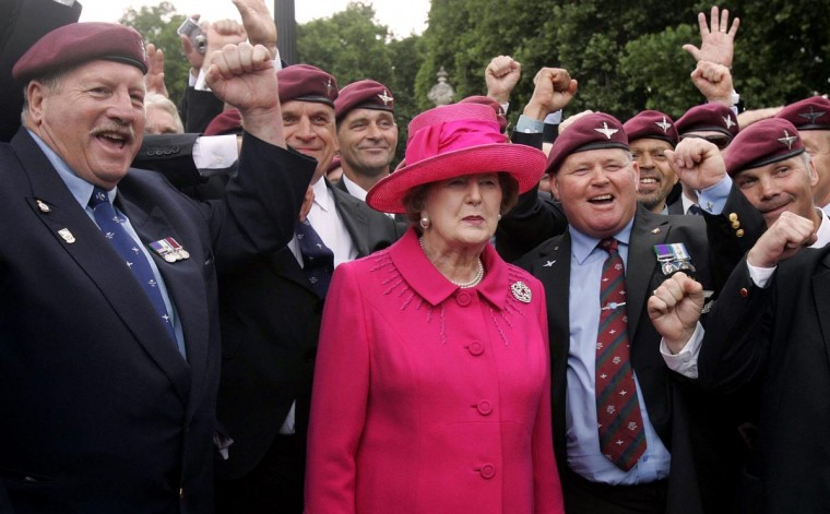 A picture dated June 17, 2007 shows former British Prime Minister Baroness Thatcher (C) posing with some former Parachute Regiment members as they take part in a 25th anniversary march of the Falkland Island conflict in London. (Alistair Grant/AFP/Getty Images)