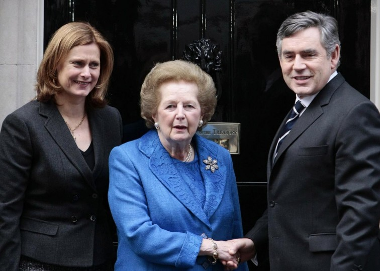 A picture dated November 23, 2009 shows former British Prime Minister Baroness Margaret Thatcher (C) posing for a photograph with then Prime Minister Gordon Brown (R) and his wife Sarah (L) outside 10, Downing Street in London following a meeting to unveil a specially commissioned portrait of Thatcher. (Carl Court/AFP/Getty Images)