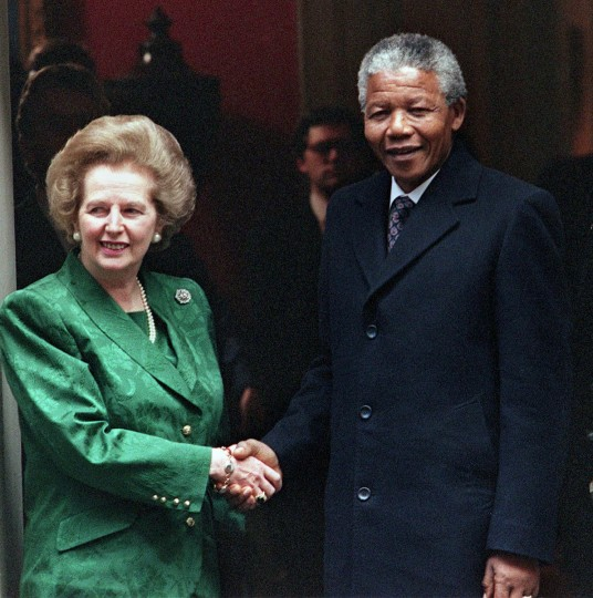 A picture dated July 4, 1990 shows South African anti-apartheid leader and African National Congress (ANC) member Nelson Mandela (R) shaking hands with then British Prime Minister Margaret Thatcher on the steps of No 10 Downing Street. (Gerry Penny/AFP/Getty Images)