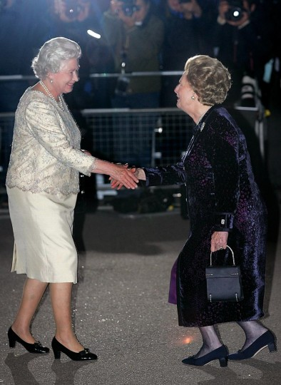 A picture dated October 13, 2005 shows Britain's former Prime Minister Lady Margaret Thatcher (R) greeting her Britain's Queen Elizabeth II, arriving for Thatcher's 80th birthday party at the Mandarin Oriental hotel in central London. (Odd Andersen/AFP/Getty Images)