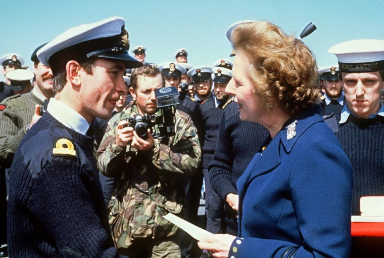 A file picture taken on January 8, 1983, shows former British Prime Minister Margaret Thatcher (R) meeting personnel aboard the ship HMS Antrim during her five-day visit to the Falkand Islands. (Sven Nackstrand/AFP/Getty Images)