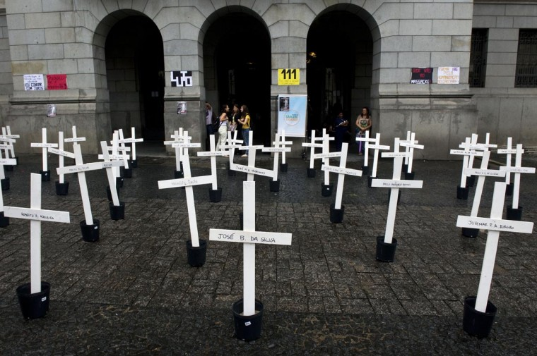 Crosses are seen in front of the School of Law of the University of Sao Paulo (USP) in homage to the inmates dead at the Carandiru Penitentiary massacre in Sao Paulo, Brazil on April 8, 2013. Twenty-six military police officers were to go on trial here Monday for the alleged execution-style killing of inmates during Brazil's deadliest prison uprising, which claimed the lives of 111 prisoners. (Nelson Almeida/AFP/Getty Images)