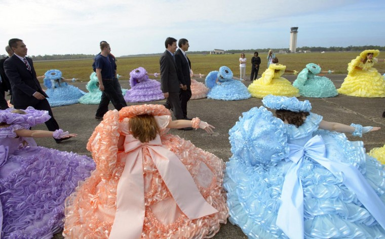 VIPs enter the ground breaking ceremony for an assembly line for the Airbus A320 at Brookley Aeroplex as ladies with the Mobile Azalea Trail Maids courtesy as they enter in Mobile, Alabama on April 8, 2013. (Matthew Hinton/AFP/Getty Images)