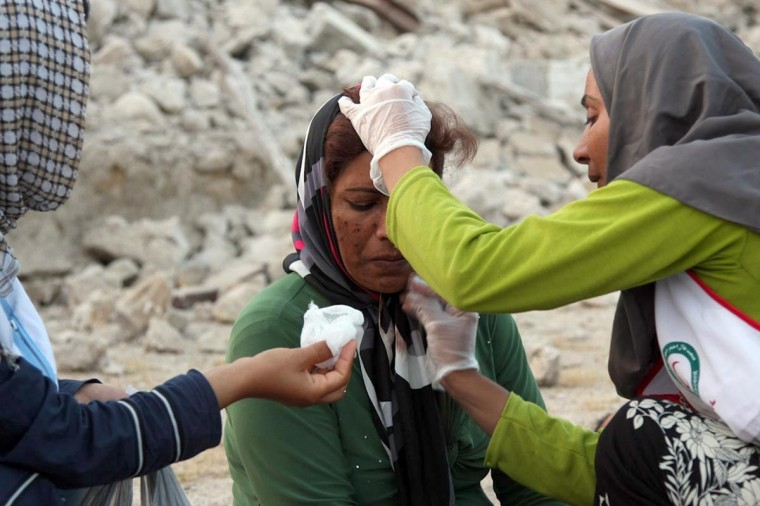 An Iranian woman receives medical treatment from aid workers in the town of Shonbeh, southeast of Bushehr, on April 9, 2013 after a powerful earthquake struck near the Gulf port city of Bushehr. The 6.1 magnitude quake killed at least 30 people and injured 800 but Iran's only nuclear power plant was left intact, officials said. (Mohammad Fatemi/AFP/Getty Images)