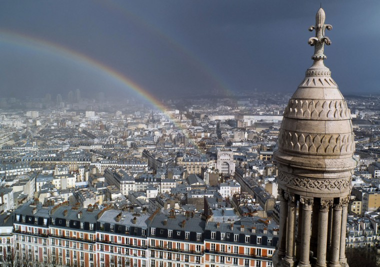 A rainbow is pictured from the top of the Sacre-Coeur basilica in the Montmartre district in Paris. (Patrick Kovarik/AFP/Getty Images)