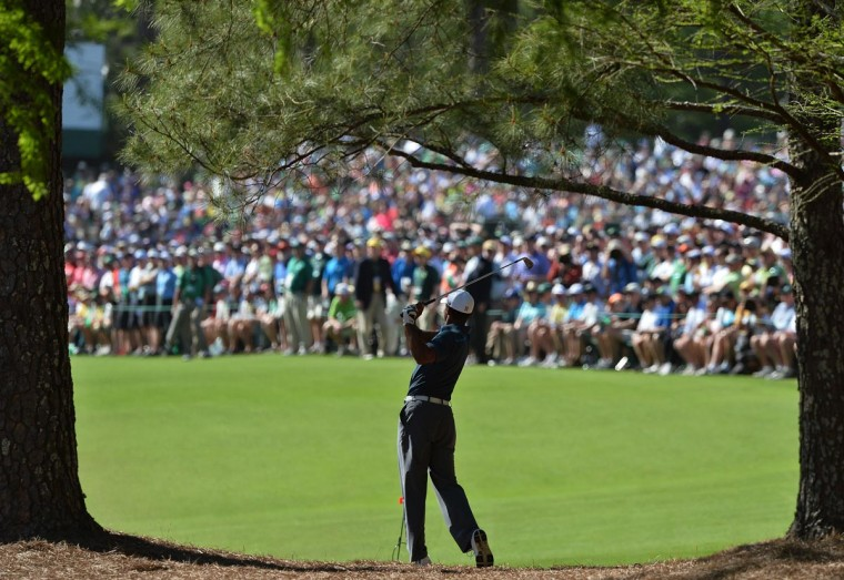 Tiger Woods of the US hits his approach shot to the 13th hole during the third round of the 77th Masters golf tournament at Augusta National Golf Club on April 13, 2013 in Augusta, Georgia. (Jewel Samad/AFP/Getty Images)