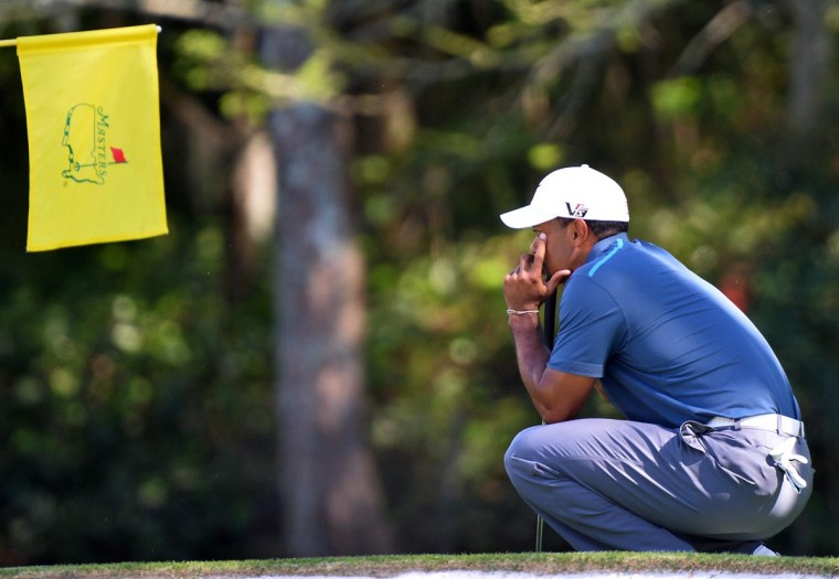 Tiger Woods of the US lines up his shot on the 11th green during the third round of the 77th Masters golf tournament at Augusta National Golf Club on April 13, 2013 in Augusta, Georgia. (Jewel Samad/AFP/Getty Images)