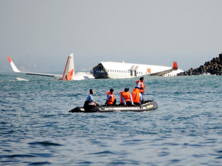 A Lion Air Boeing 737 lies submerged in the water after missing the runaway during landing at Bali's international airport near Denpasar on April 14, 2013. The Indonesian plane carrying more than 100 passengers broke in two after missing the runway at Bali airport on April 13 and landing in the sea, leaving dozens injured but no fatalities. (Sonny Tumbelaka/AFP/Getty Images)