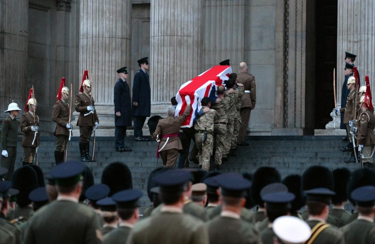 Honor guard from the three military services carry a coffin as they take part in a rehearsal for the ceremonial funeral of former prime minister Margaret Thatcher on the steps of St Paul's Cathedral in the city of London, on April 15, 2013. Thatcher, who died on April 8 following a stroke at the age of 87, will receive the high honour of a ceremonial funeral with military honours on April 17. (Ben Stansall/AFP/Getty Images)